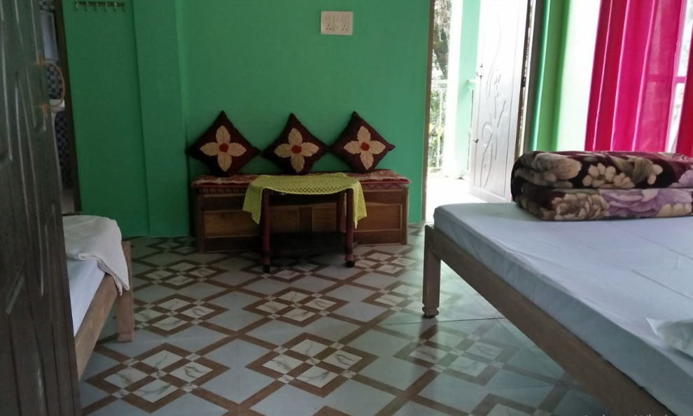Humro Homestay Suntalekhola best deluxe bed room including attached bathroom and mirror