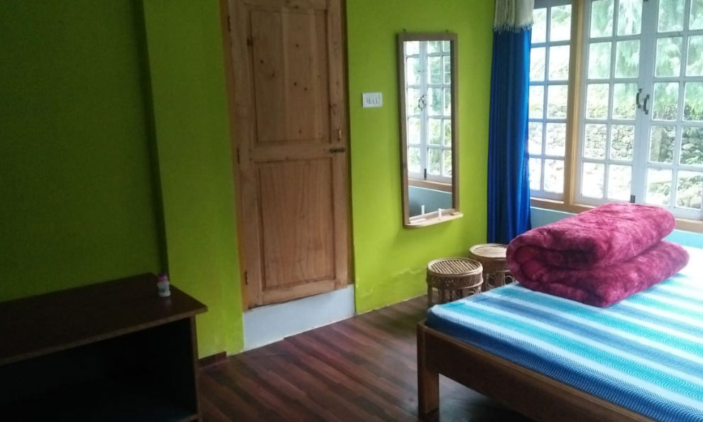 Humro Homestay Suntalekhola nice bed room including attached bathroom and mirror