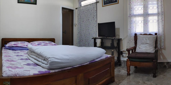 Jaldakha home stay big bed room with tv and chair